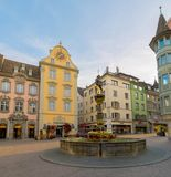 Schaffhausen, SH  / Switzerland - 22 April 2019: historic fountain and square in the old town of Schaffhausen with people milling. About royalty free stock photos