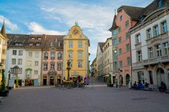 Schaffhausen, SH  / Switzerland - 22 April 2019:the historic fountain and town square in the old town of the Swiss city of. Schaffhausen royalty free stock photo