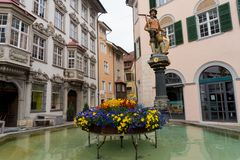 Schaffhausen, SH  / Switzerland - 22 April 2019:the historic Tellenbrunnen fountain and town square in the old town of the Swiss. City of Schaffhausen stock image