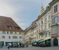 Schaffhausen, SH / Switzerland - 22 April, 2019: the pedestrian zone and historic old town of Schaffhausen with people eating out. And walking around stock images