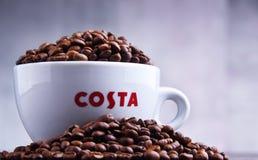 Schale Costa Coffee-Kaffee und -bohnen stockbilder