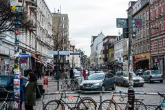 Schanzenviertel in Hamburg, Germany. HAMBURG, GERMANY � FEBRUARY 8, 2014: People , cars and bicycles in Schanzenviertel, the rather controversial in quarter on Royalty Free Stock Image