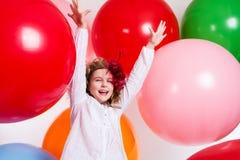 Schastivaya joyful girl on a large balloons Royalty Free Stock Photography