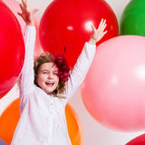Schastivaya joyful girl on a large balloons Royalty Free Stock Images