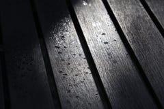 Schatten auf dem Holz Stockfoto