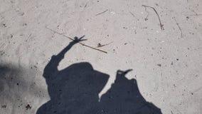 Schatten auf dem Sand stockfoto