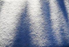 Schatten auf dem Schnee Lizenzfreies Stockfoto