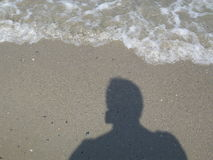 Schatten auf dem Strand Stockfoto