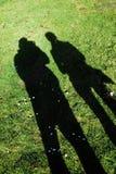Schatten auf Gras Stockbild