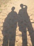 Schatten auf Sand Stockbild