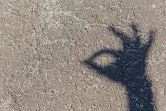 Schatten der Hand am Boden Lizenzfreies Stockfoto