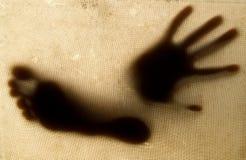 Schatten der Hand und des Fußes Lizenzfreies Stockfoto