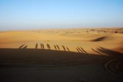 Schatten der Leute in der Wüste Lizenzfreies Stockfoto