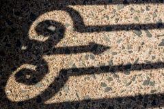 Schatten des aufwändigen Schmiedeeisenzauns, Rockville, Connecticut Lizenzfreie Stockfotografie