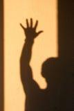 Schatten des Mannes auf einer Wand Lizenzfreie Stockfotografie