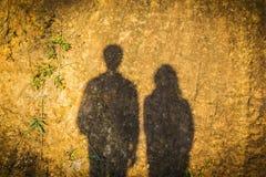 Schatten des Mannes und der Frau Stockbilder
