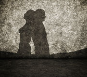 Schatten des Mannes und der Frau auf Wand Stockfotografie