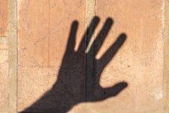 Schatten einer Hand Stockbild
