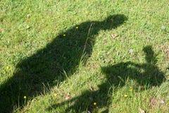 Schatten eines Kameramanns Stockfoto