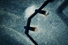 Schatten für fesselnde Eisenplatten Lizenzfreie Stockfotos