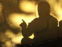 Schatten und Betrachtung Stockfotografie
