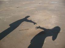 Schatten von tne zwei Leuten Stockfotos