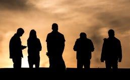 Schattenbild auf Sonnenuntergang Lizenzfreie Stockfotografie