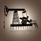 Schattenbild, das für Öl mit Reflexion schaukelt Stockfotos