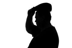 Schattenbild der prallen Mannabnutzung ein Hut mit einer Maske Stockbilder