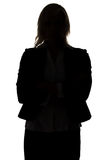 Schattenbild der stehenden Geschäftsfrau Lizenzfreie Stockfotografie