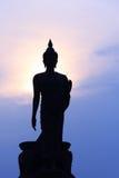 Schattenbild der Stellung von Buddha-Statue Stockbild