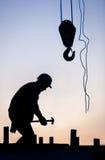 Schattenbild des Bauarbeiters Stockfotos