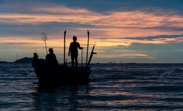 Schattenbild des Fischers Stockbilder