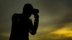 Schattenbild des Fotografen Stockfoto