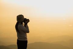 Schattenbild des Fotografen Foto machend Stockfotografie