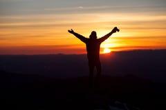 Schattenbild des Fotografen im Sonnenuntergang Lizenzfreie Stockfotos