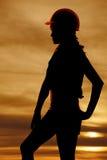 Schattenbild des Frauenbauhandhüftensonnenuntergangs Stockbilder