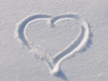 Herz auf Schnee Stockfotos