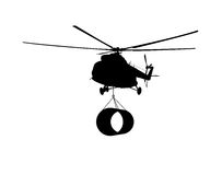 Schattenbild des Hubschraubers mit der Last. Stockfoto