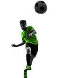 Schattenbild des jungen Mannes des Fußballfußballspielers Lizenzfreie Stockfotos