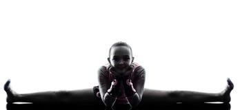 Schattenbild des kleinen Mädchens der rhythmischen Gymnastik Stockfotografie