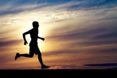 Schattenbild des laufenden Mannes Lizenzfreie Stockbilder