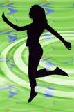 Schattenbild des Mädchens mit Digital-Musik-Spieler lizenzfreie stockfotografie