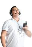 Schattenbild des Mannes mit Kopfhörern (rückseitige Leuchte) Lizenzfreies Stockfoto