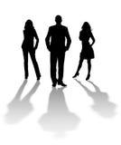 Schattenbild des Mannes und der Frauen Stockbild