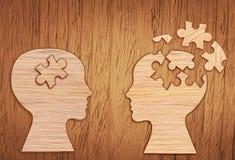 Schattenbild des menschlichen Kopfes, Symbol der psychischen Gesundheit Puzzlespiel Stockbild