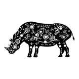 Schattenbild des Nashorns mit alten Mustern von afrikanischen Stämmen in t Lizenzfreie Stockbilder