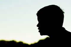 Schattenbild des Profils des Jungen Lizenzfreie Stockfotos