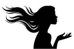 Schattenbild des schönen Mädchens im Profil mit dem langen Haar stockfoto