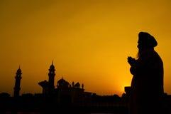 Schattenbild des Sikhgebets Stockbild